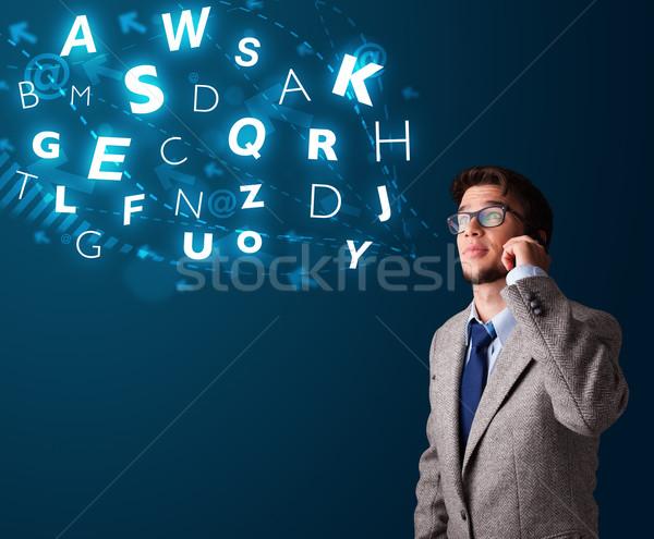 Fiatal srác készít telefonbeszélgetés fényes betűk jóképű Stock fotó © ra2studio