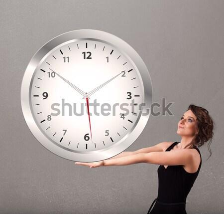 Aantrekkelijk dame reusachtig klok jonge Stockfoto © ra2studio