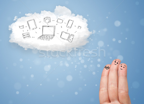 Happy cheerful smiley fingers looking at cloud computing with technology icons Stock photo © ra2studio