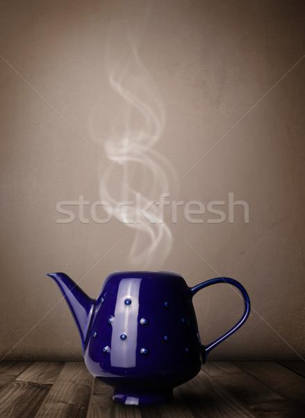 Tea pot with abstract white steam Stock photo © ra2studio