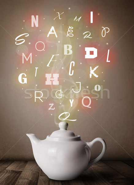Tea pot with colorful letters Stock photo © ra2studio