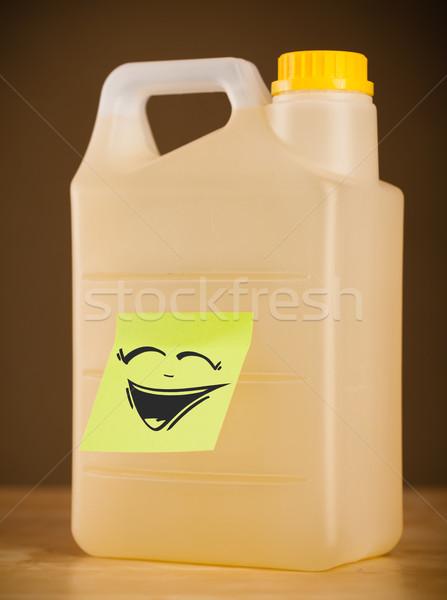 Note gallon papier heureux Photo stock © ra2studio