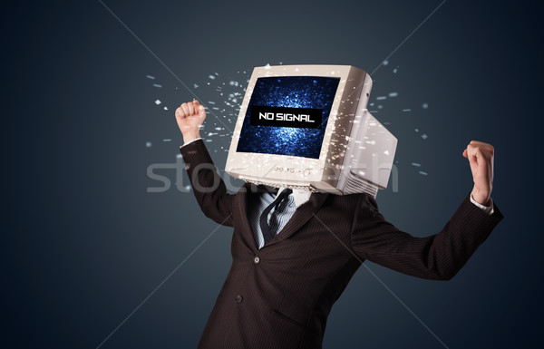 Man with a monitor head, no signal sign on the display stock
