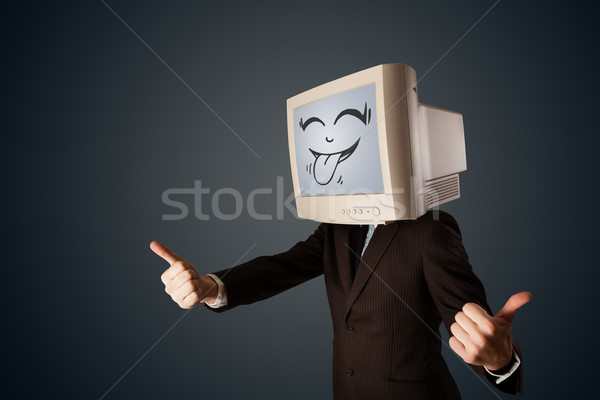 Happy business man with a computer monitor and a smiley face Foto stock © ra2studio