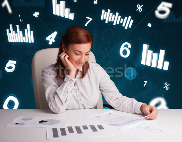 Jonge zakenvrouw vergadering bureau diagrammen statistiek Stockfoto © ra2studio
