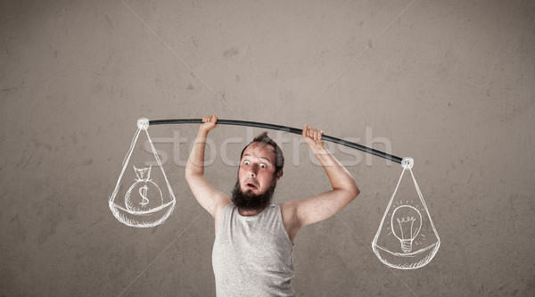 Stock photo: skinny guy trying to get balanced