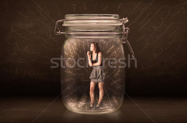 Femme d'affaires à l'intérieur jar puissant dessinés à la main lignes Photo stock © ra2studio