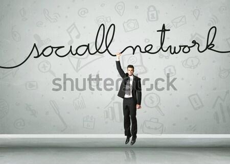 Opknoping zakenman touw business hand Stockfoto © ra2studio