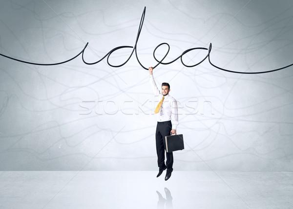 Opknoping zakenman idee touw hemel hand Stockfoto © ra2studio