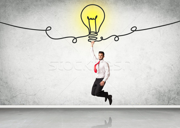 Suspendu affaires idée ampoule main aider Photo stock © ra2studio