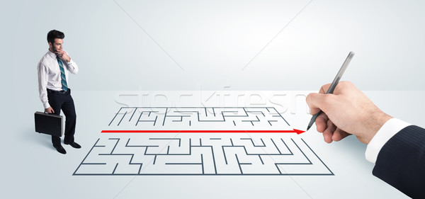 Business man looking at hand drawing solution for maze  Stock photo © ra2studio