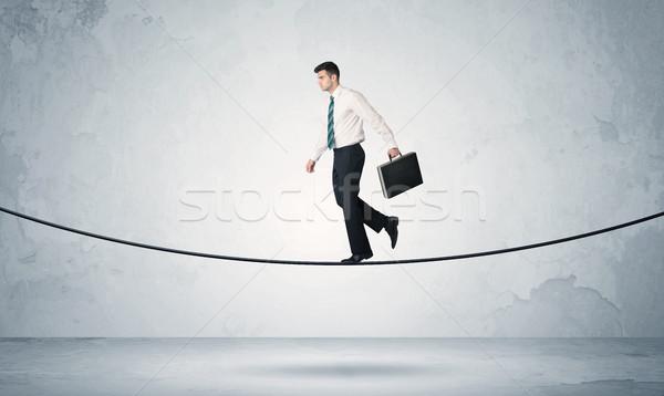 Vendite ragazzo bilanciamento stretto corda imprenditore Foto d'archivio © ra2studio