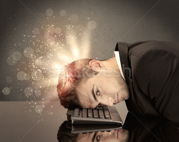 Angry businessman with lights and keyboard Stock photo © ra2studio