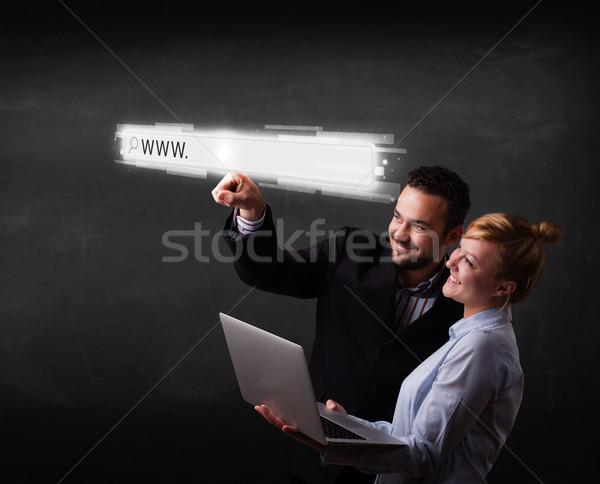 молодые бизнеса пару прикасаться веб браузер Сток-фото © ra2studio
