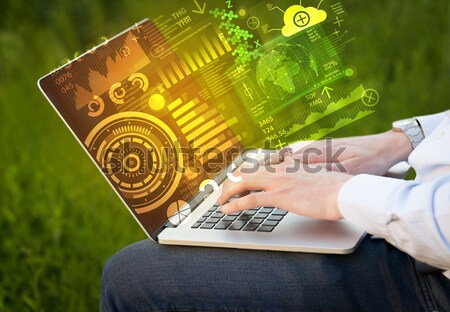 Modern notebook computer with future technology symbols Stock photo © ra2studio