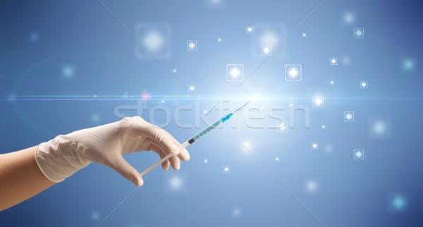 Foto stock: Feminino · médico · seringa · mão · brilhante