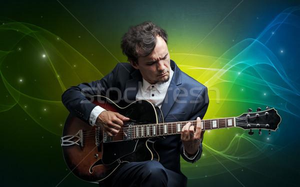 Gitarist renkli ciddi klasik duvar kağıdı Stok fotoğraf © ra2studio