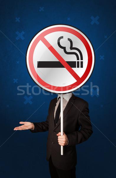 Businessman holding no smoking sign Stock photo © ra2studio