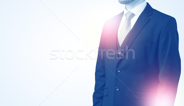 Young businessman standing and thinking Stock photo © ra2studio