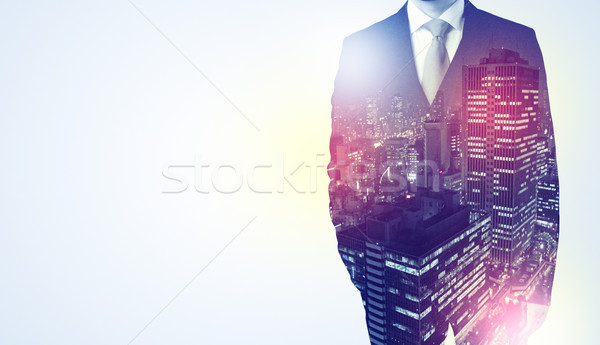 Businessman standing with night city graphic Stock photo © ra2studio