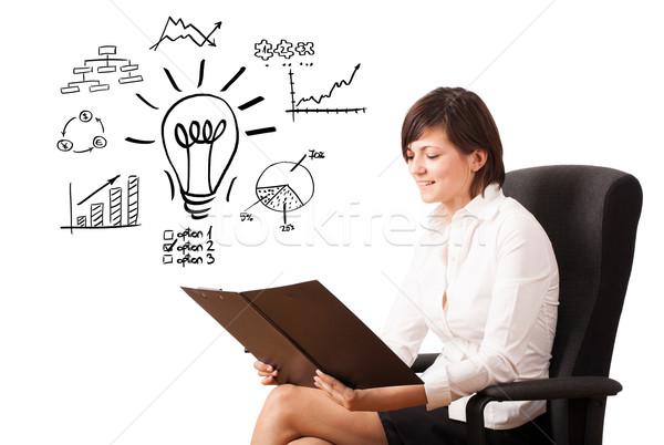 Foto stock: Jovem · mulher · de · negócios · diagramas