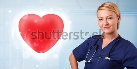 Zdjęcia stock: Młodych · pielęgniarki · uzdrowienie · czerwony · serca · dość