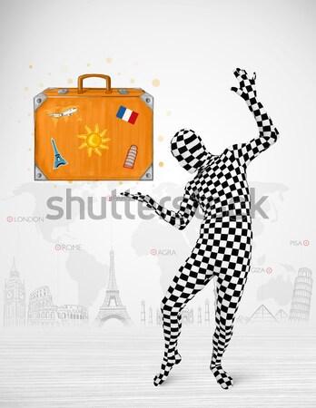 Uomo suit vacanze valigia Foto d'archivio © ra2studio