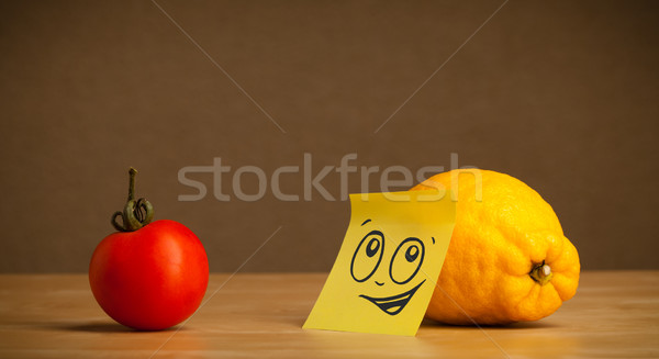 Lemon with post-it note looking at tomato Stock photo © ra2studio