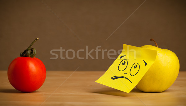 Apple with sticky post-it note looking sadly at tomato Stock photo © ra2studio