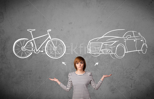 Stock photo: Woman making a choice between bicycle and car
