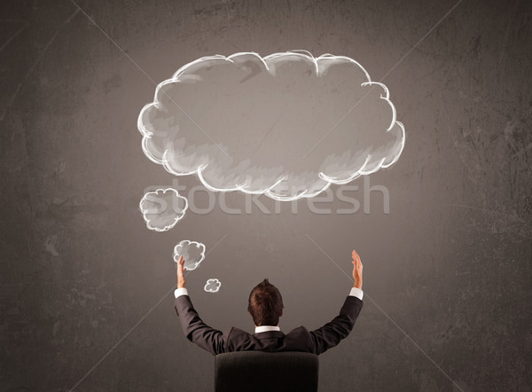Businessman sitting with cloud thought above his head Stock photo © ra2studio