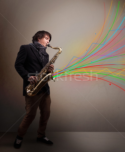 Atractivo músico jugando saxófono colorido resumen Foto stock © ra2studio
