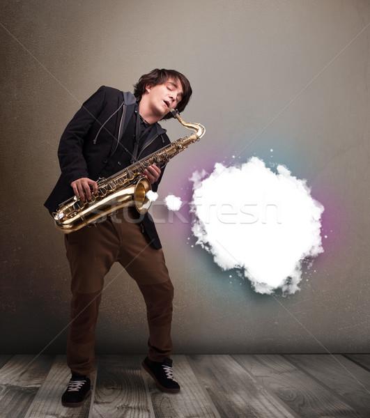 若い男 演奏 サクソフォン コピースペース 白 雲 ストックフォト © ra2studio