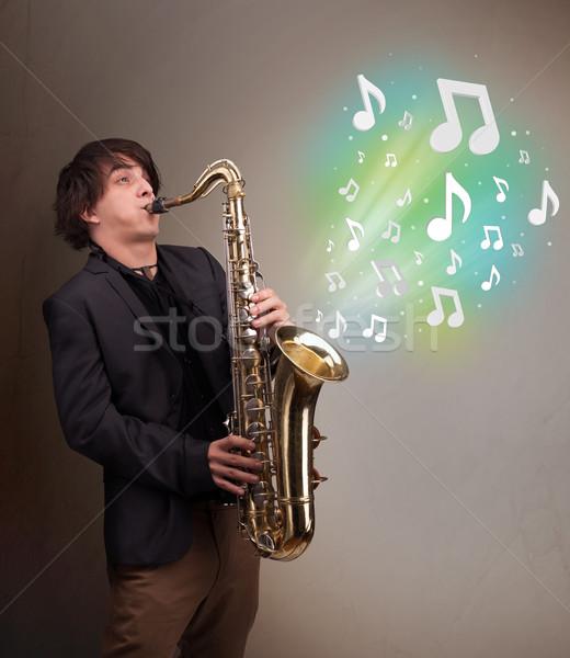 молодые музыканта играет саксофон музыки отмечает привлекательный Сток-фото © ra2studio