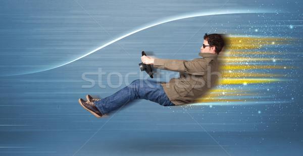 Fiatalember vezetés képzeletbeli gyors autó elmosódott Stock fotó © ra2studio