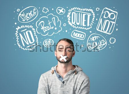 Young man with glued eye and thought clouds Stock photo © ra2studio
