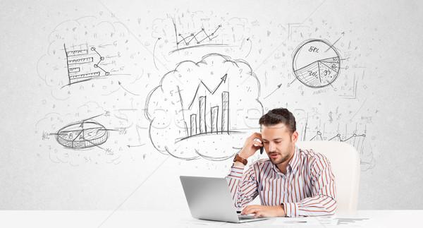 üzletember ül asztal kézzel rajzolt grafikon táblázatok Stock fotó © ra2studio