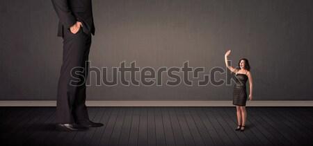 Wenig Riese Chef Beine Frau Hintergrund Stock foto © ra2studio