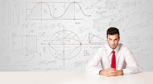 бизнесмен бизнеса деловой человек сидят белый таблице Сток-фото © ra2studio
