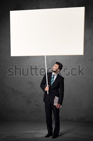 Businessman with blank whiteboard Stock photo © ra2studio