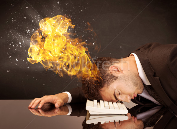 Stressed business man's head is burning Stock photo © ra2studio