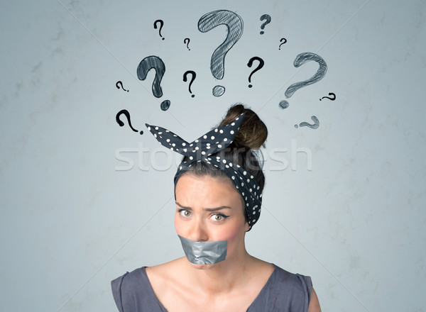 Young woman with glued mouth and question mark symbols Stock photo © ra2studio