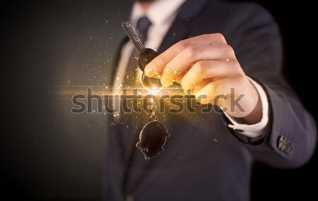 Hand with remote control and shining numbers Stock photo © ra2studio