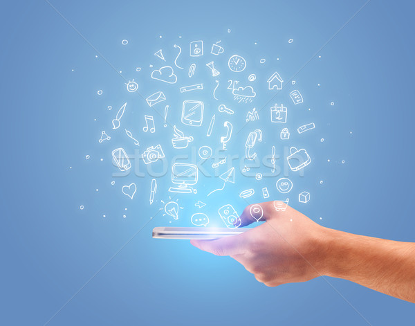 Hand with phone and drawn office icons Stock photo © ra2studio