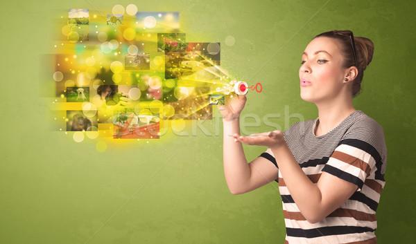 Aranyos lány fúj színes izzó emlék Stock fotó © ra2studio