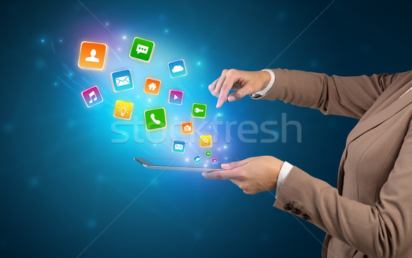 Application icons going in tablet Stock photo © ra2studio