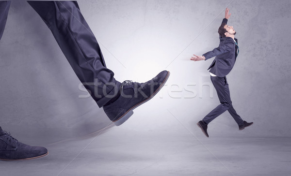 Foot kicking, businessman flying Stock photo © ra2studio
