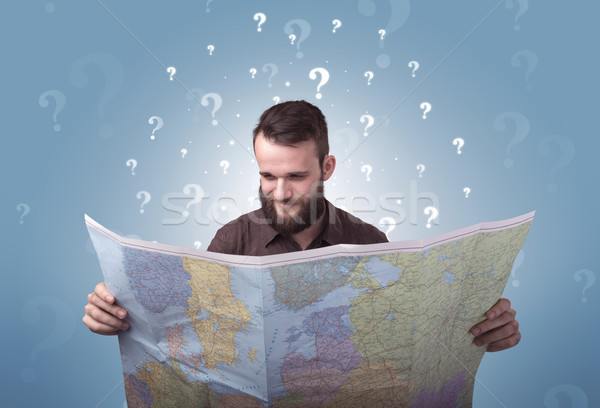 Jonge man kaart knap witte vraagtekens Stockfoto © ra2studio