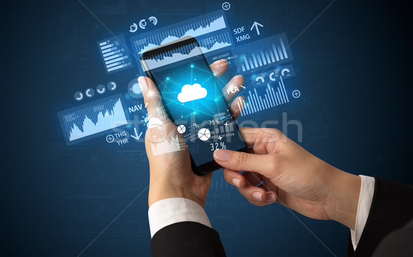 Hand using phone with financial tracking concept  Stock photo © ra2studio