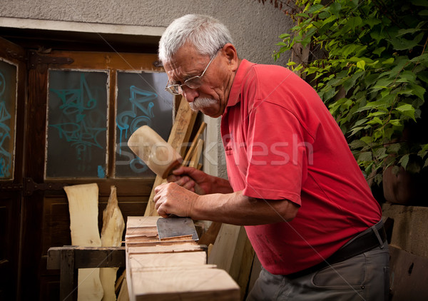 woodcarver working with mallet and chisel Stock photo © ra2studio